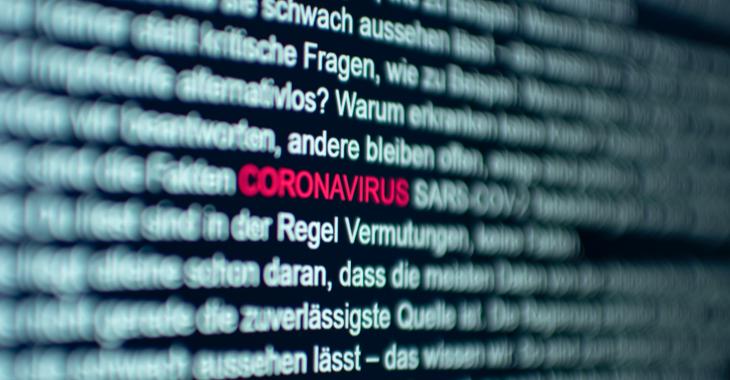 Das Wort Coronavirus in einem Text auf einem Computerbildschirm ist rot hervorgehoben ©iStock/pxel66